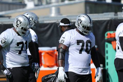 Oakland Raiders offensive linemen, from left, tackle Justin Murray (71) and guard Jonathan Coop ...