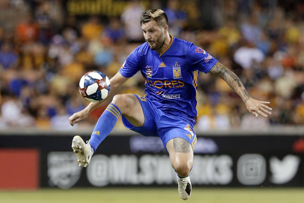 Tigres' Andre-Pierre Gignac jumps to bring down the ball during the second half of a UANL Leagu ...