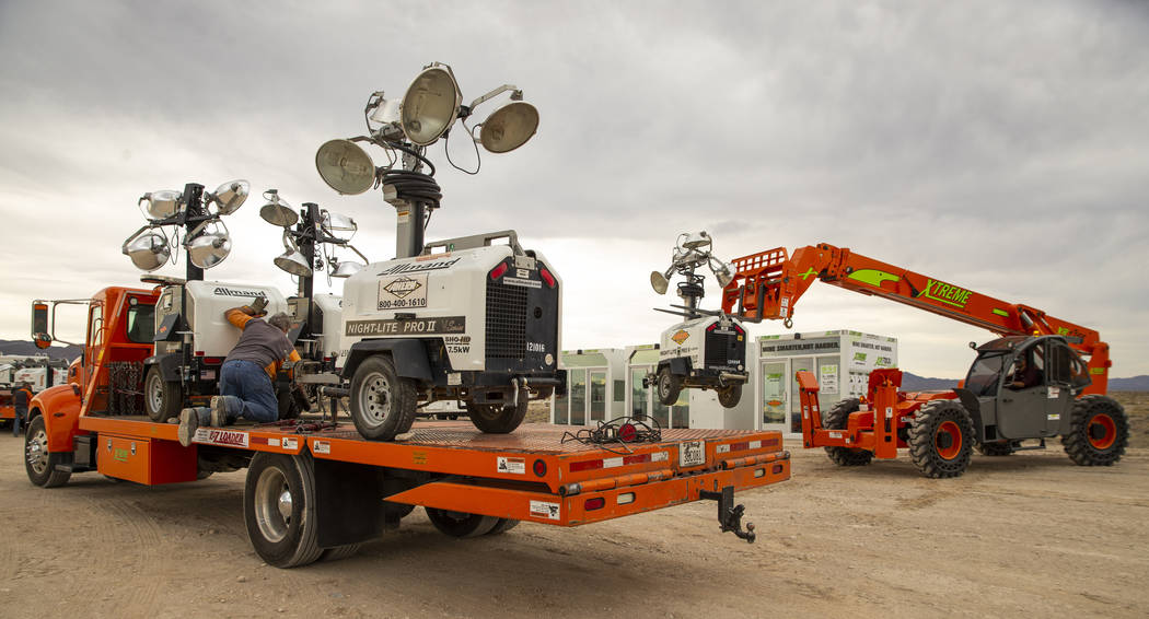 A crew with Ahern Rentals unloads equipment in the Area 51 Basecamp about the Alien Research Ce ...