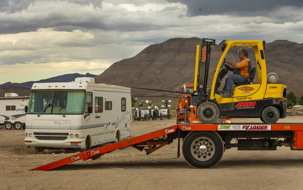 A crew with Ahern Rentals moves equipment in the Area 51 Basecamp about the Alien Research Cent ...