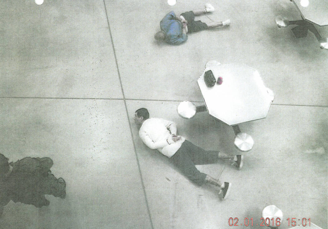 Anthony Williams and Tarik Goicoechea are handcuffed on the floor of High Desert State Prison a ...