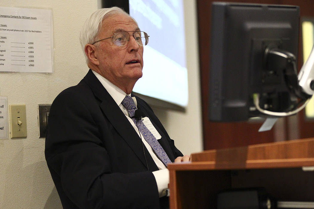 Dr. Weldon Havins, professor of medical jurisprudence and ophthalmology, teaches a continuing m ...