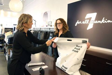 Dropit Regional Manager Lihi Levin scans a shopping bag as she demonstrates how mobile app Drop ...