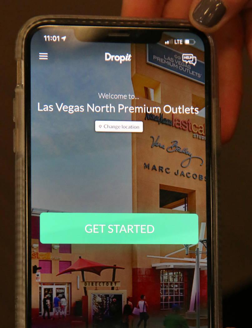 Dropit Regional Manager Lihi Levin demonstrates how mobile app Dropit works at 7- for All Man K ...