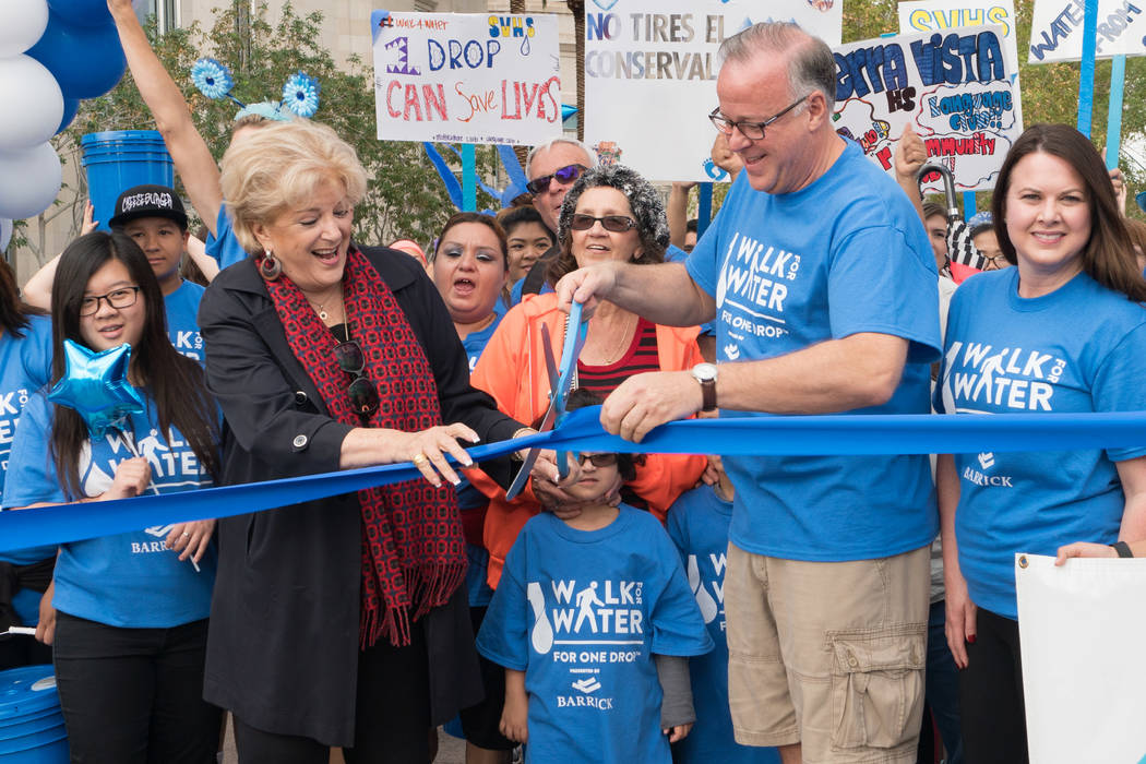 Mayor Carolyn Goodman and Jerry Nadal of Cirque du Soleil cut the ribbon at One Drop Walk for W ...