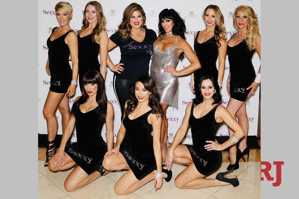 """Emily Simpson and Jennifer Romas, center, are shown with the cast of """"Sexxy the Show,"""" featured ..."""