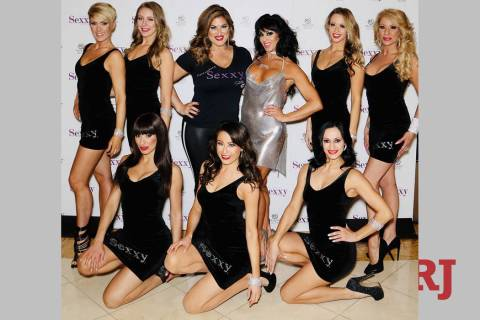 "Emily Simpson and Jennifer Romas, center, are shown with the cast of ""Sexxy the Show,"" featured ..."