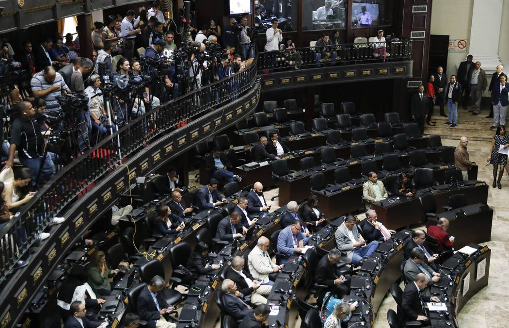 Opposition lawmakers attend a weekly session as the chairs belonging to the pro-government lawm ...
