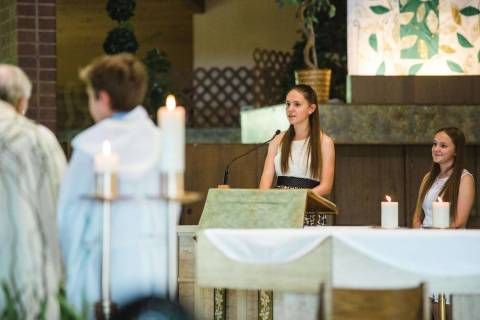 Paula Davis, center, speaks next to her sister during the wedding of her aunt and uncle at St. ...