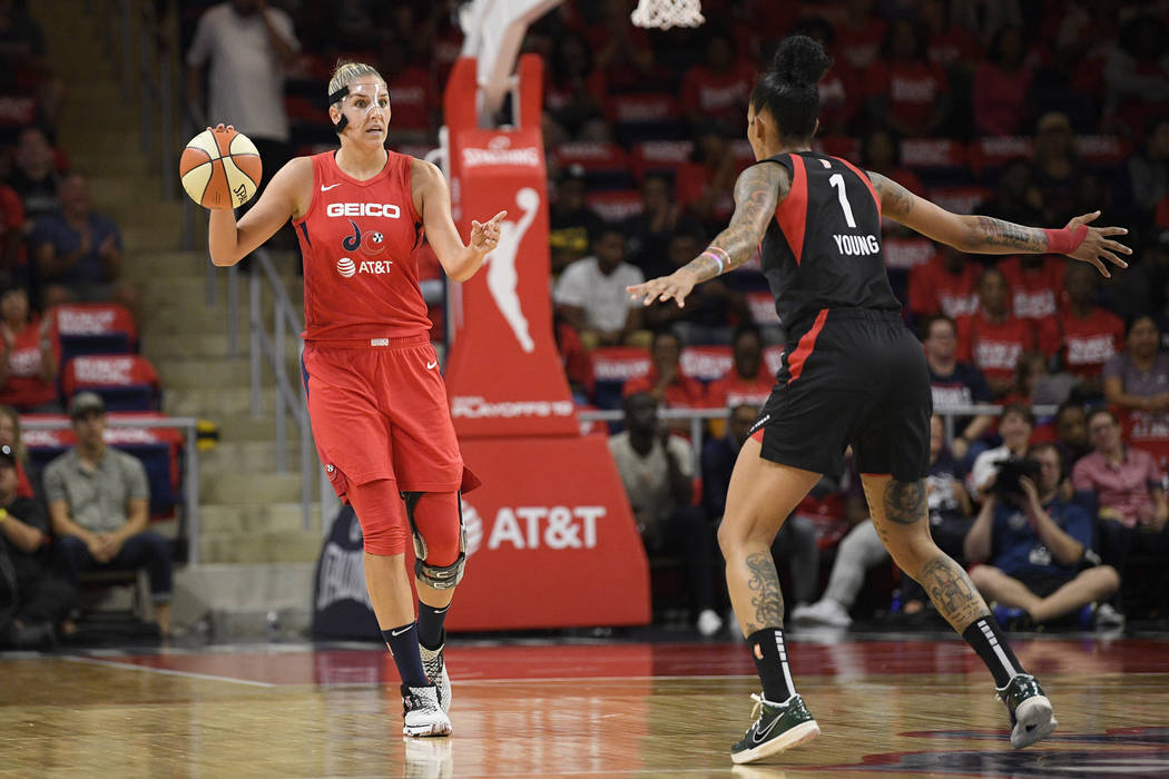 Washington Mystics forward Elena Delle Donne, left, dribbles the ball in front of Las Vegas Ace ...