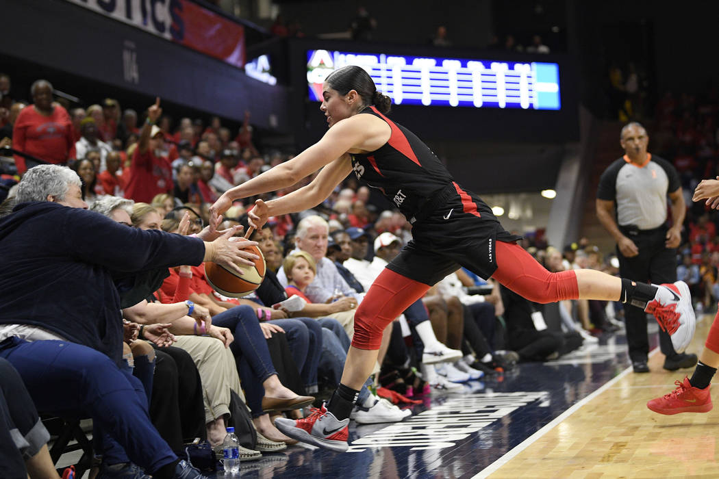 Las Vegas Aces guard Kelsey Plum chases a ball that went out of bounds, during the first half a ...