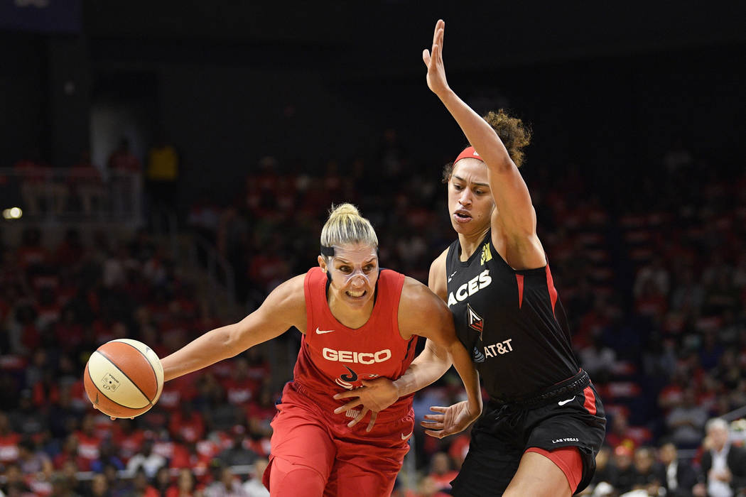 Washington Mystics forward Elena Delle Donne, left, drives to the basket against Las Vegas Aces ...