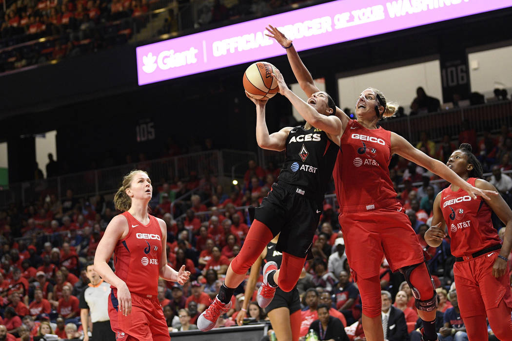 Las Vegas Aces guard Kelsey Plum, second from left, goes to the basket against Washington Mysti ...