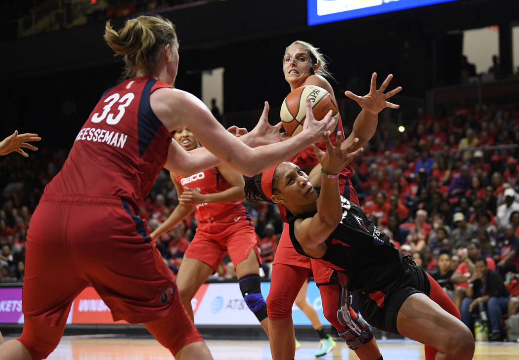 Las Vegas Aces center A'ja Wilson, right, battles for the ball against Washington Mystics cente ...