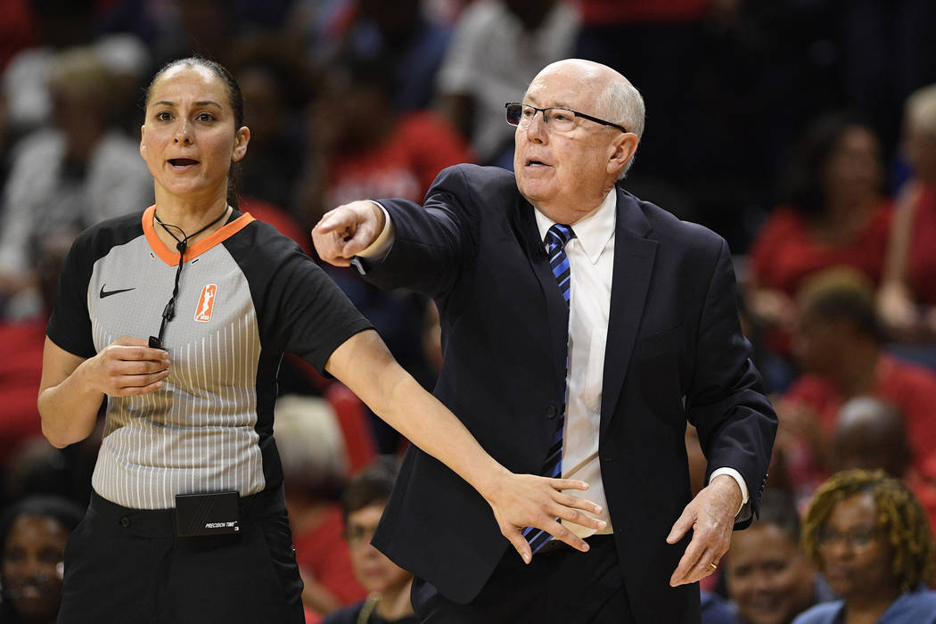 Washington Mystics coach Mike Thibault, right, points next to an official during the second hal ...