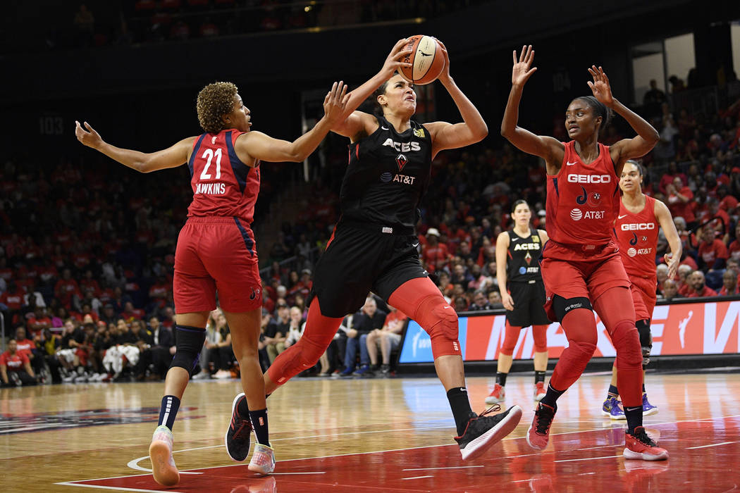 Las Vegas Aces center Liz Cambage (8) goes to the basket against Washington Mystics forward Tia ...
