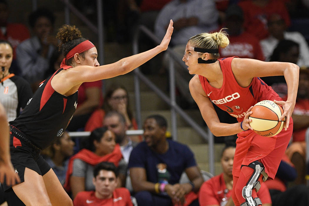Las Vegas Aces forward Dearica Hamby, left, guards Washington Mystics forward Elena Delle Donne ...