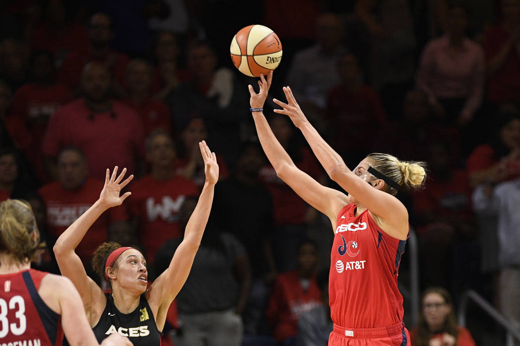 Washington Mystics forward Elena Delle Donne, right, shoots against Las Vegas Aces forward Dear ...