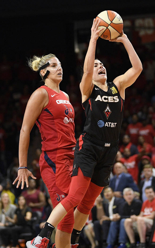 Las Vegas Aces guard Kelsey Plum throws up a shot in front of Washington Mystics forward Elena ...