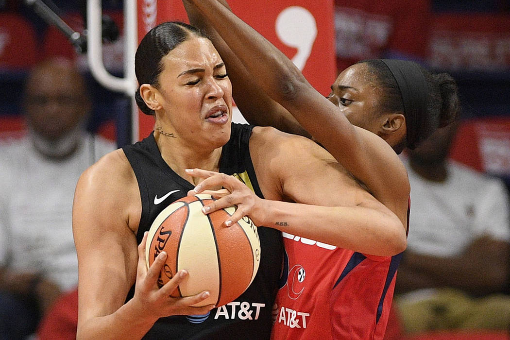 Washington Mystics forward LaToya Sanders, right, guards Las Vegas Aces center Liz Cambage duri ...