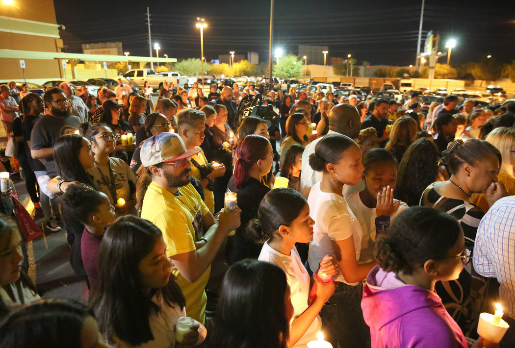 People gather at the Sobe Ice Arena during a candlelight vigil for Mark Garcia and his daughter ...