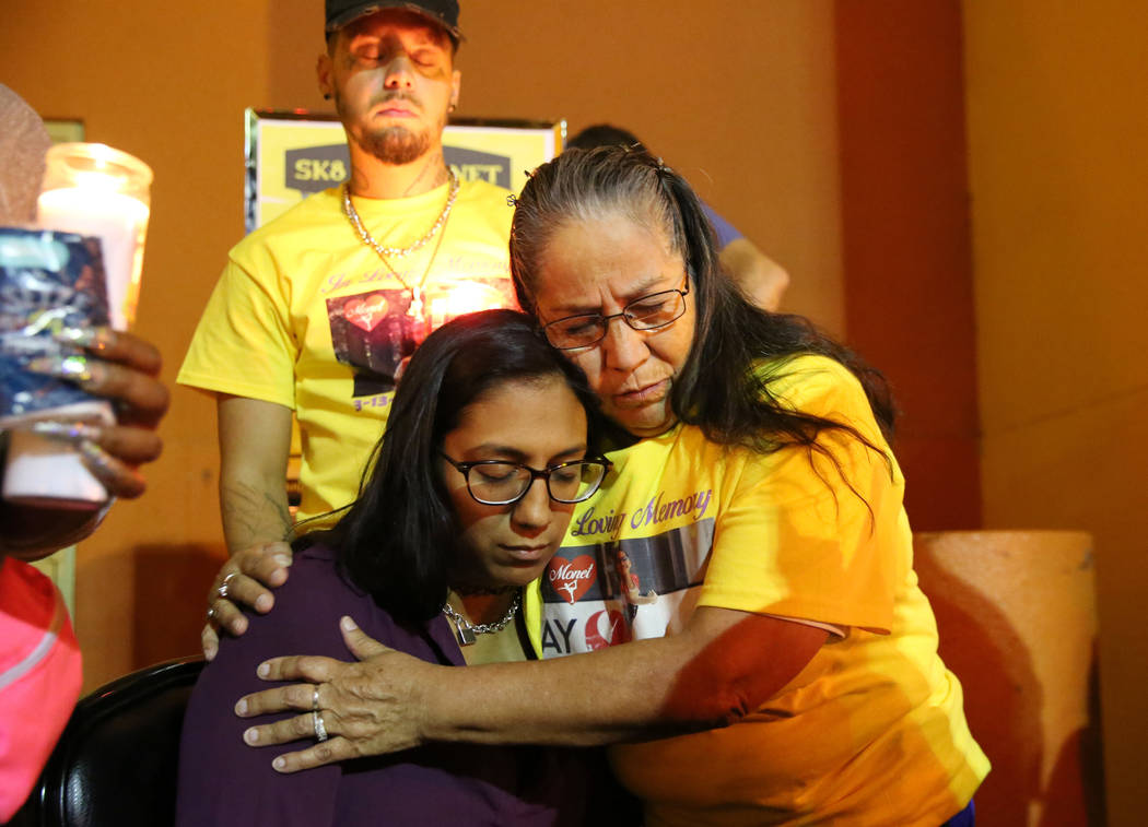 Maria Conchos, left, mother of Monet Garcia, comforted by her mother Josefina Conchos, during a ...