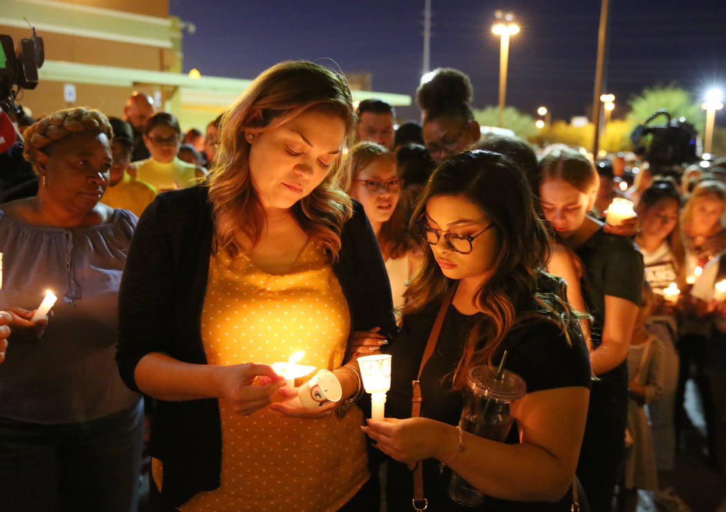 Veronica Robles, left, sister of Mark Garcia, and her daughter Jazmyn, 17, attend a candlelight ...
