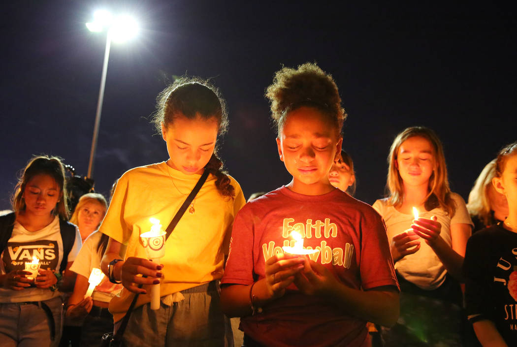 Monet Garcia's schoolmates gather at the Sobe Ice Arena during a candlelight vigil for Mark Gar ...