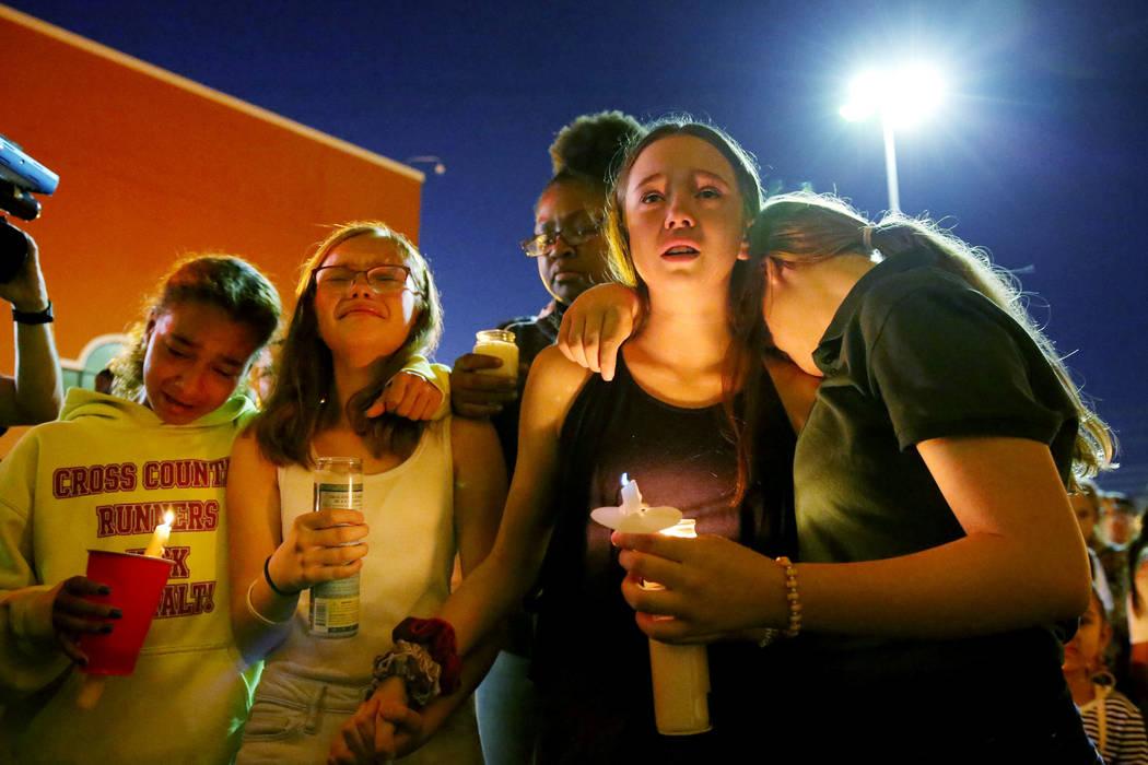 Monet Garcia's friends MacKenna Calvin, 12, from left, Diamond Espinosa, 12, Layla McKnight, 12 ...