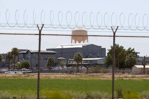 FILE - In this July 23, 2014 file photo, a fence surrounds the state prison in Florence, Ariz., ...