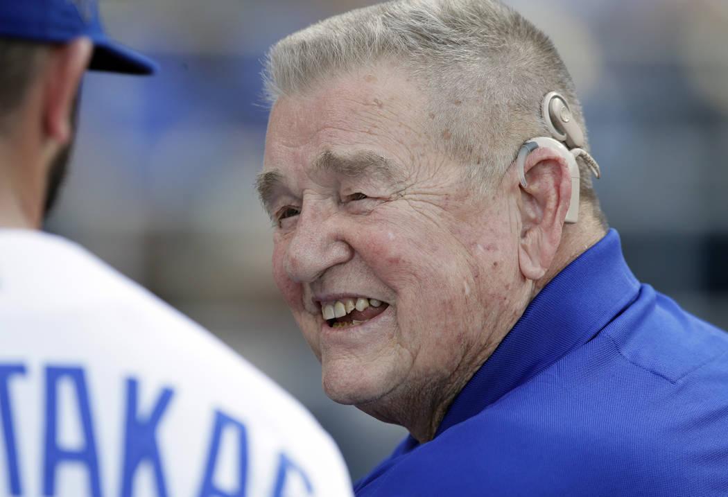 Former Kansas City Royals manager Whitey Herzog smiles while talking with Royals' Mike Moustaka ...