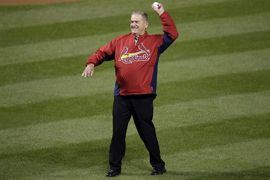 Formal St. Louis Cardinals manager Whitey Herzog throws out the ceremonial first pitch before G ...