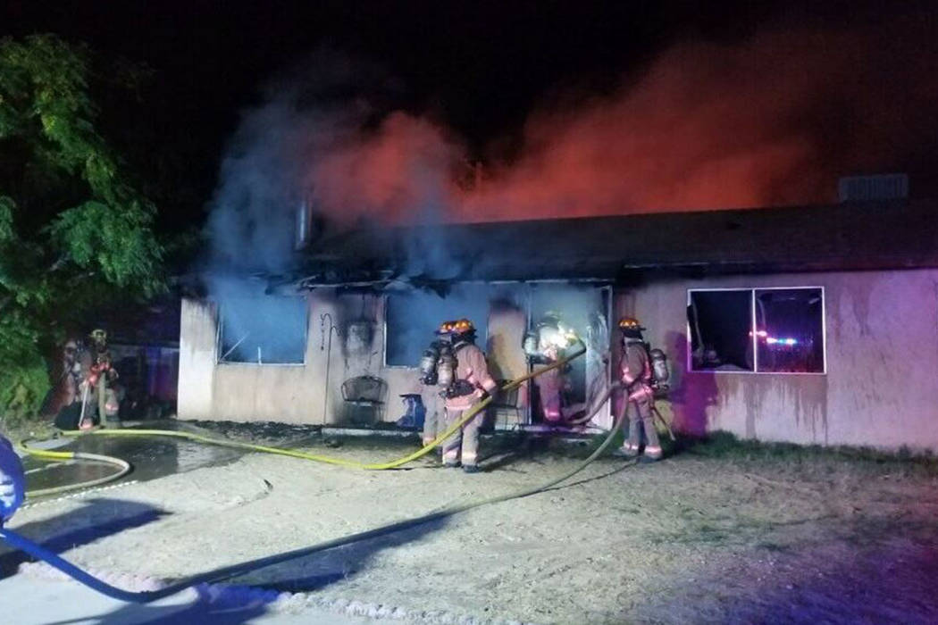 Crews battle a fire Tuesday, Sept. 17, 2019, on the 6100 block of Sonoma Circle in Las Vegas. ( ...