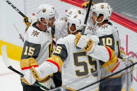 Vegas Golden Knights center Nicolas Roy (10) celebrates a goal with teammates Jon Merrill (15), ...
