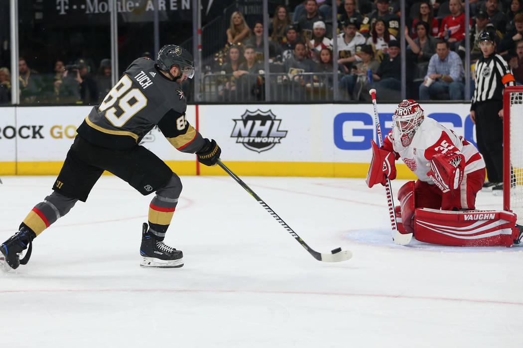 Vegas Golden Knights right wing Alex Tuch (89) takes a shot for a miss against Detroit Red Wing ...
