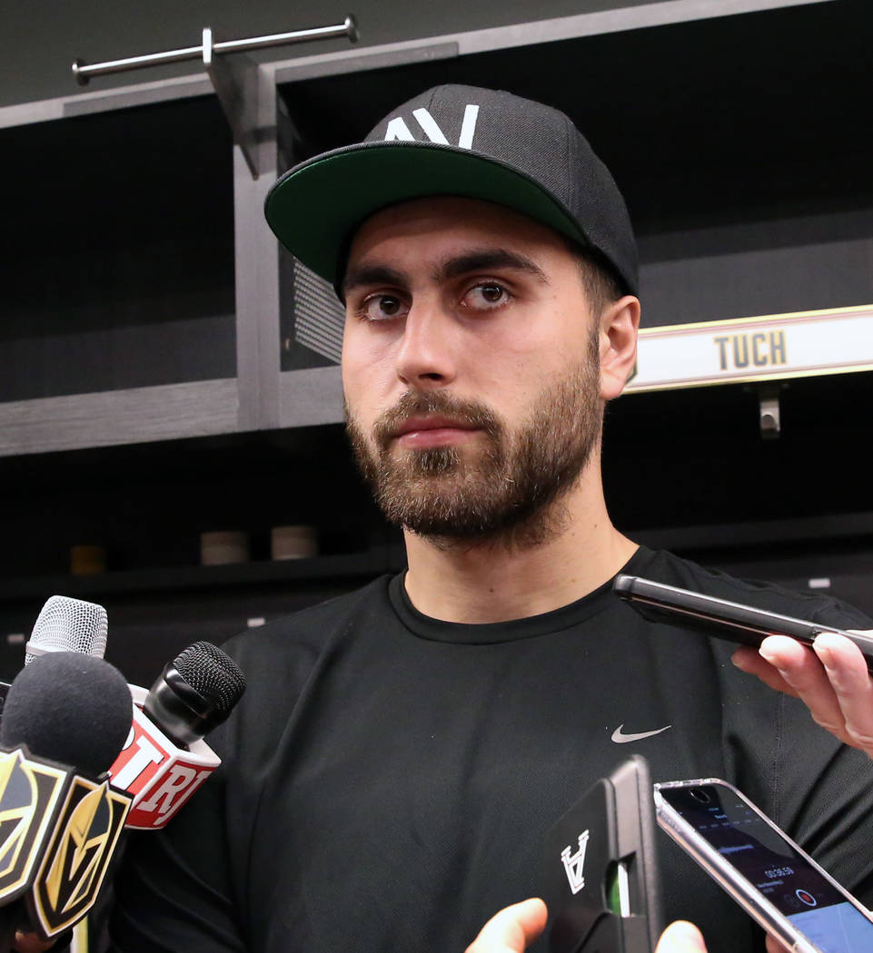 Golden Knights right wing Alex Tuch listens to reporters questions as he addresses the media at ...