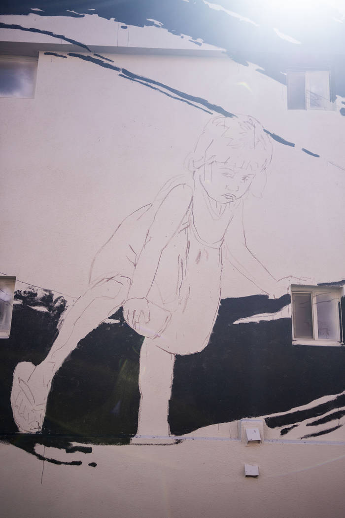 Lithuania artist Ernest Zacharevic's mural in progress in preparation for Life is Beautiful mus ...