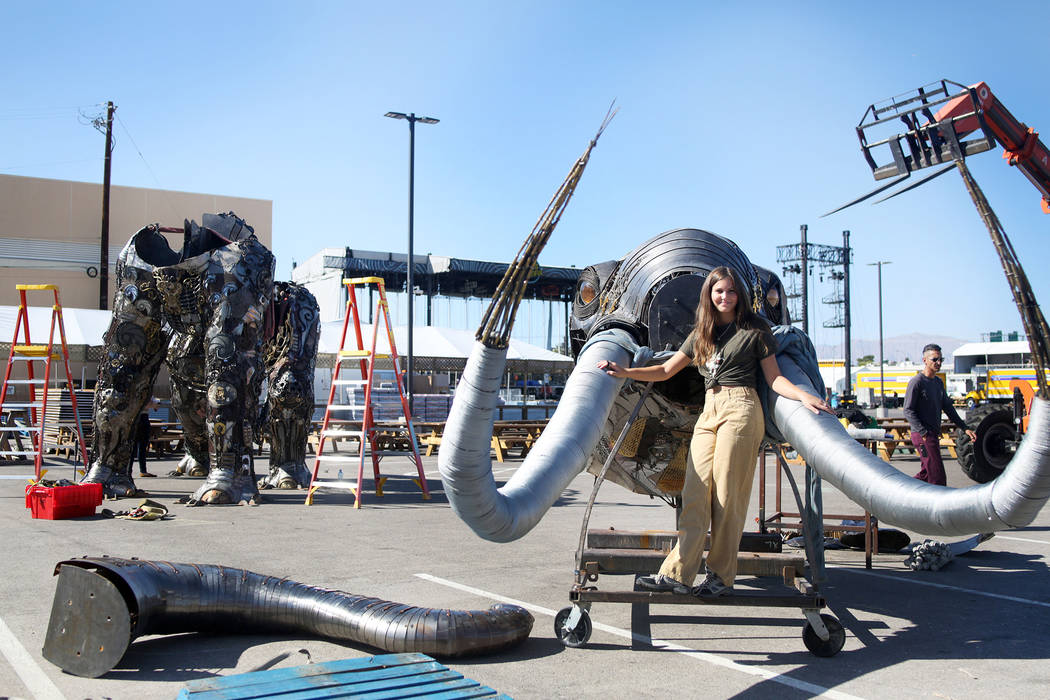 "Local Las Vegas artist Tahoe Mack, 18, with her sculpture of the ""Monumental Mammoth"" that is b ..."