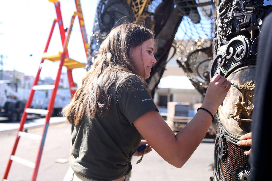 "Local Las Vegas artist Tahoe Mack, 18, works on her sculpture of the ""Monumental Mammoth"" in pr ..."