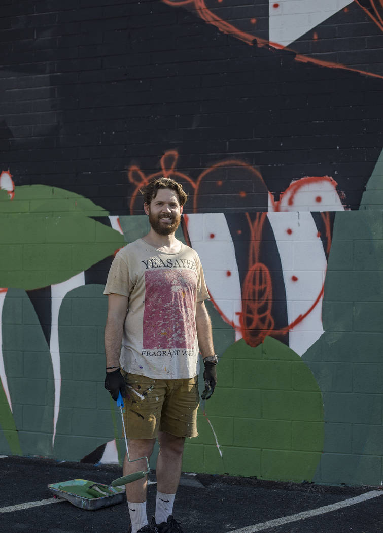 "Artist Eric Vozzola stands in front of his mural-in-progress ""An Allegory of Natural Beaut ..."