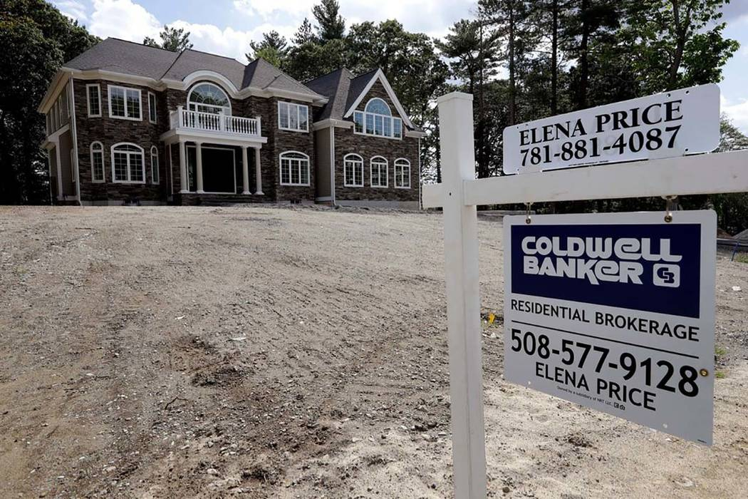In this Tuesday, Sept. 3, 2019 photo a sign rests in front of a newly constructed home, in West ...