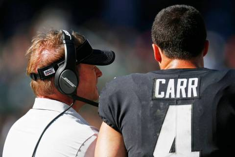 Oakland Raiders quarterback Derek Carr (4) and head coach Jon Gruden stand on the sidelines dur ...