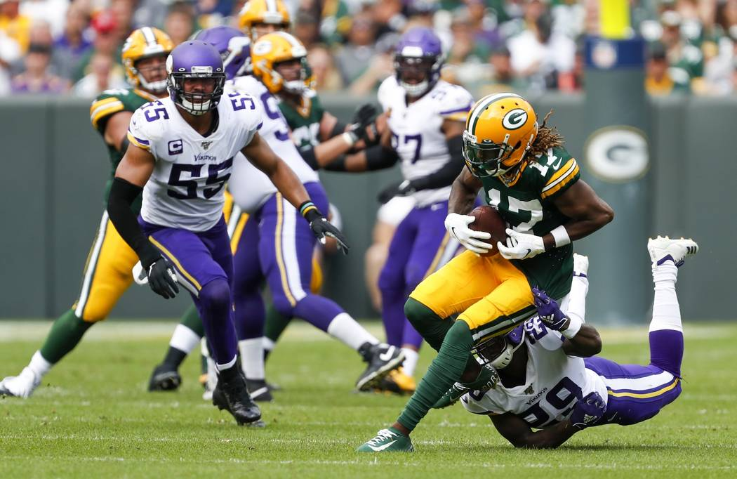 Green Bay Packers' Davante Adams runs after catching a pass during the second half of an NFL fo ...