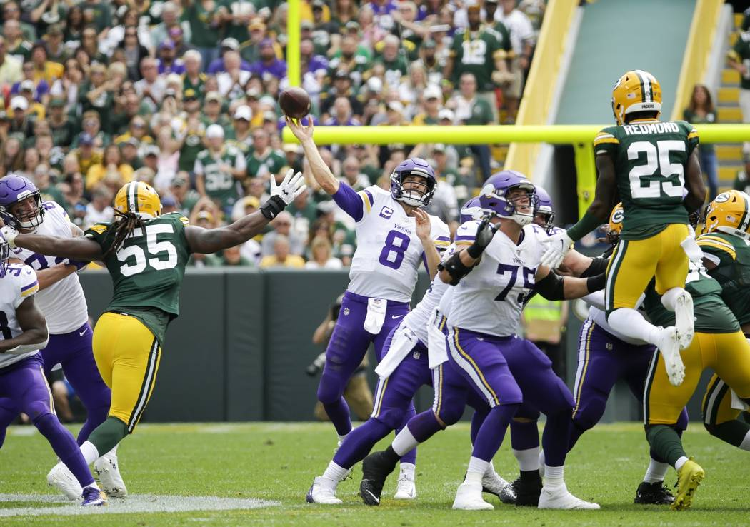 Minnesota Vikings' Kirk Cousins throws during the second half of an NFL football game against t ...