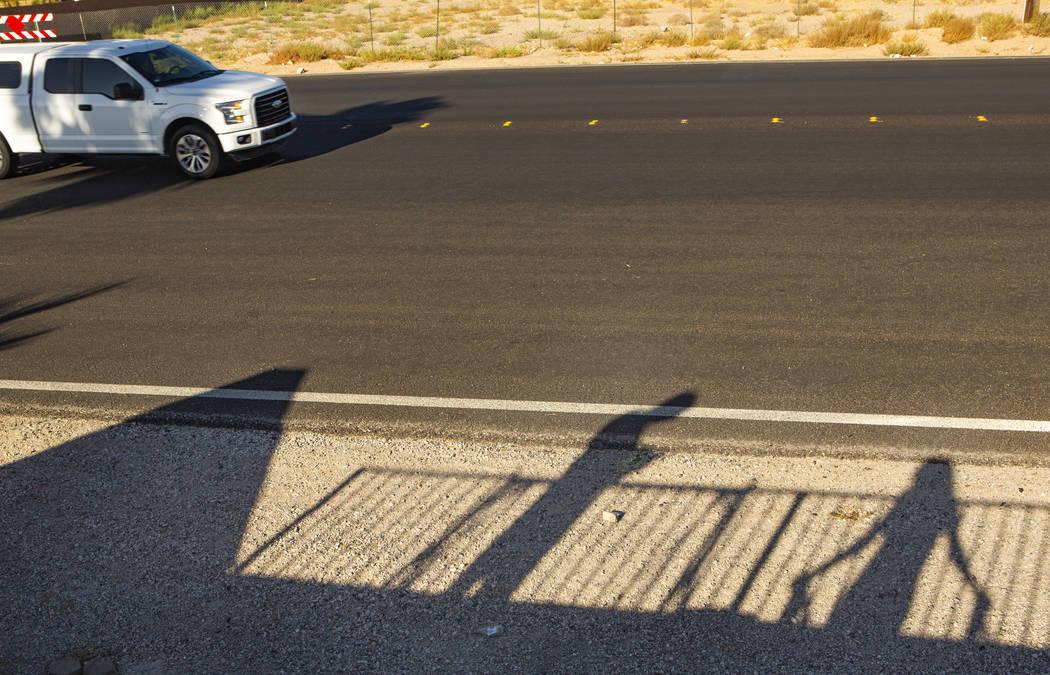 Trevor Schneider, left, and his wife, Mirza Schneider, watch trucks drive through a no-trucks z ...