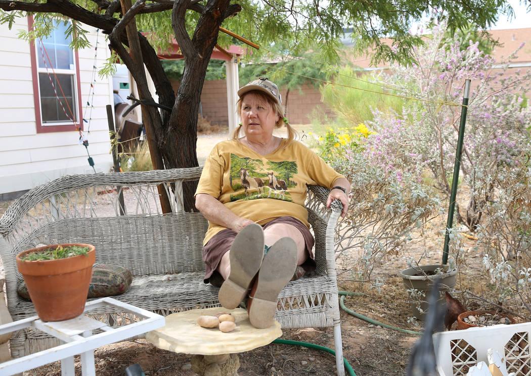 Susan Lorenz, 62, relaxes in her garden on Monday, Sept. 23, 2019, in Las Vegas. (Bizuayehu Tes ...
