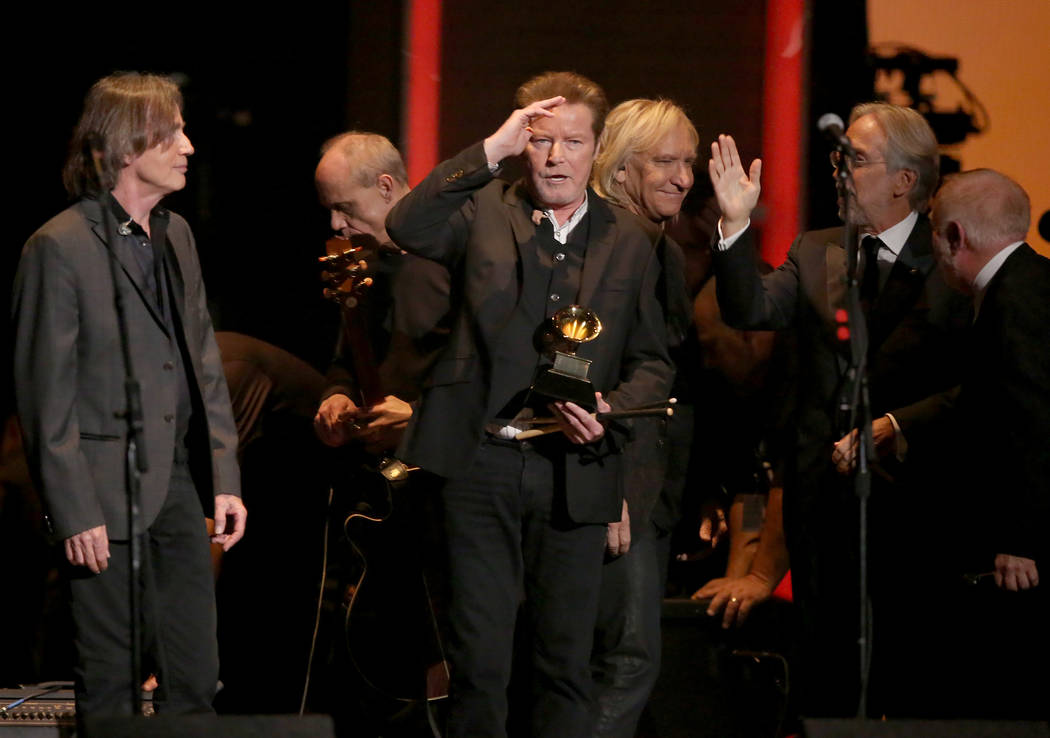 "Don Henley, center, holds The Eagles' 1978 Grammy award for record of the year for ""Hote ..."