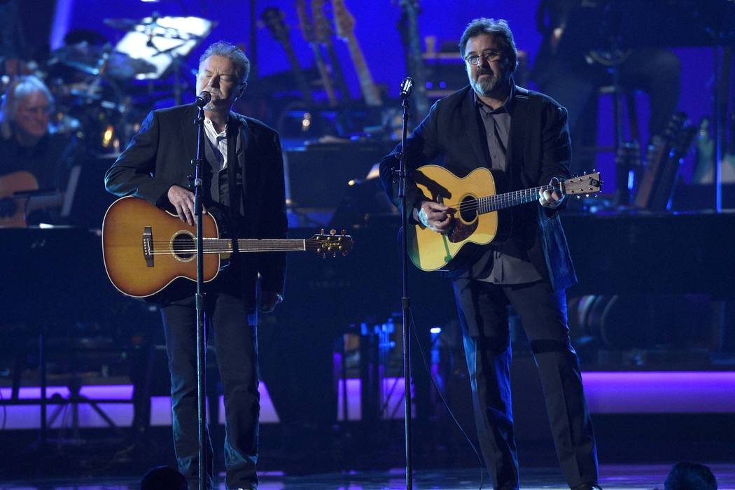 "Don Henley, left, and Vince Gill perform ""Eagle When She Flies"" at MusiCares Person of the Year ..."