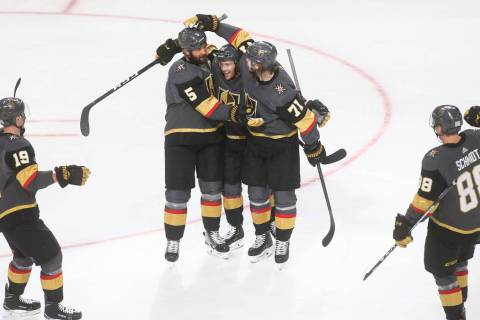 Golden Knights defenseman Deryk Engelland (5) celebrates his goal with Jonathan Marchessault, c ...