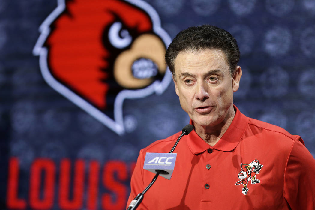 Then-Louisville NCAA college basketball head coach Rick Pitino answers a question during the At ...